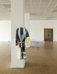 Towelling Bathrobe (Bademantel), hanging tailored garment, from found objects, 2016. Installation view at BARS AND CAFES, Haubrok Foundation, Berlin.